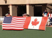 The flags of both countries hang on center court.