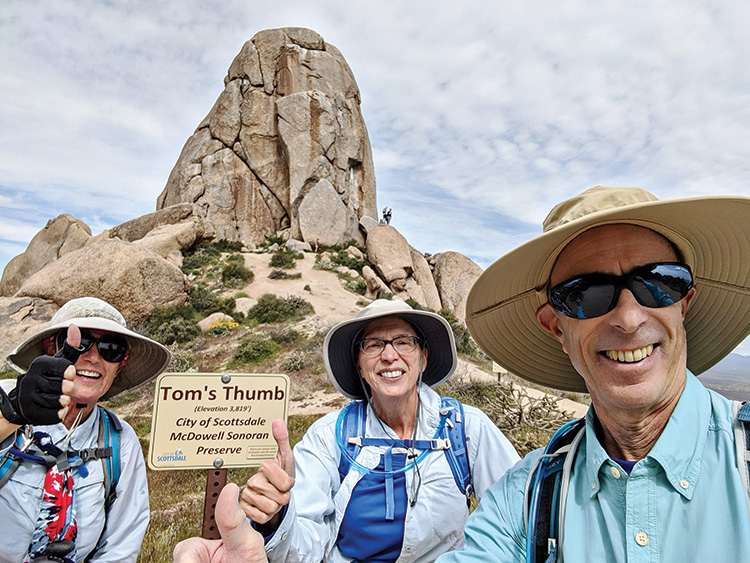 Sun Lakes Hiking Club members DeEtte Faith, Diane Alessi, and Henry Silberblatt enjoy the view near Tom's Thumb last month in the Scottsdale McDowell Sonoran Preserve. (Photo by Henry Silberblatt)