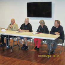 At the table are Tony Horn, Ed Campion, Dan Thorsen, Faye Haynes, and Rick Kendall.