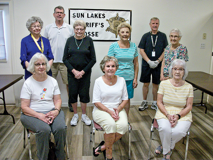 Sun Lakes Posse Medical Equipment Associates: 1st row: Bonnie McCulloh, Judy Livingston, Office Manager Phyllis Swanson; 2nd row: Pat Herbert, Suzanne Thorne, Pat Kreiling (Donations), Betty Sanders; 3rd row: Bill Shedd (future Posse member), Ron Schaab