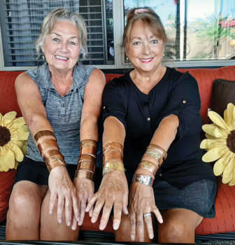 Sandy Peterson and Patti O'Neill show off a variety of bracelets created in the SLRGS Club shop using copper and mixed metals.