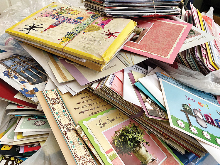 Used cards ready to be refashioned into new ones for The Crystal Card Project