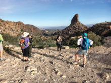 Sun Lakes Hiking Club members Tracy Nilsen and DeEtte Faith enjoy views of Weaver's Needle atop the Peralta Trail in the Superstitions Wilderness. (Photo by Warren Wasescha)