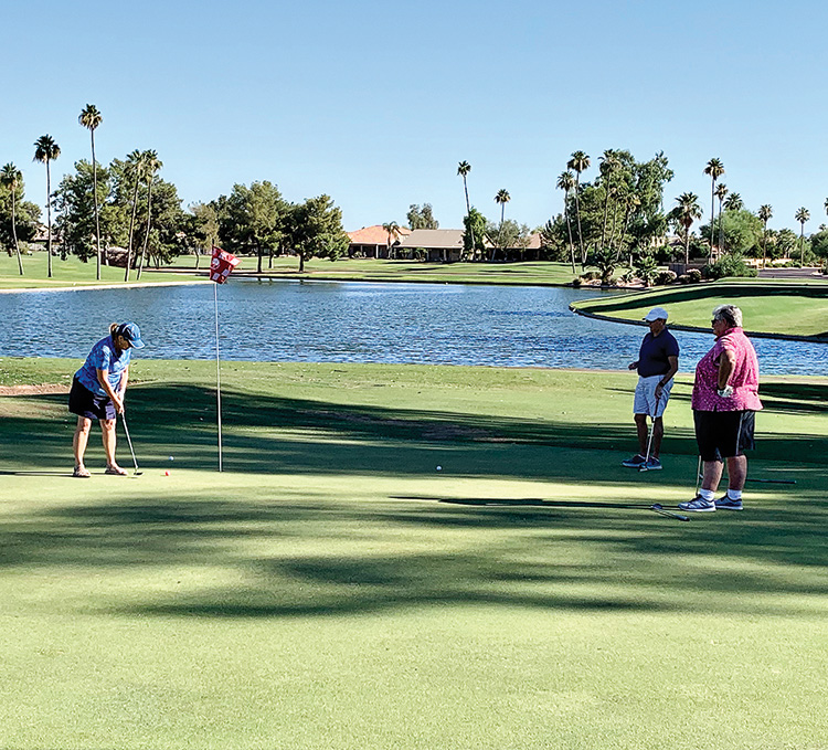 Summer play on Oakwood Palms number 7. Golfers (left to right): Patty Fanzo, Pam Matassarin, and Lynn Matassarin