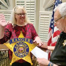 Victoria Romero recites the Arizona Rangers oath from Sun Lakes Captain Ron Burchett.