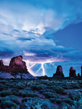 """Lightning in the Gap at the Arches National Park"" by Tom Jones"