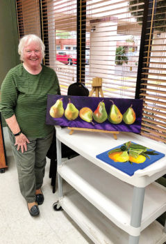 """Pictured is longtime member Kathie Neffenger with her """"Pears"""" acrylic paintings at our Share Your Art Exhibit this past January. We sure had a wonderful time sharing our art and our friendships."""