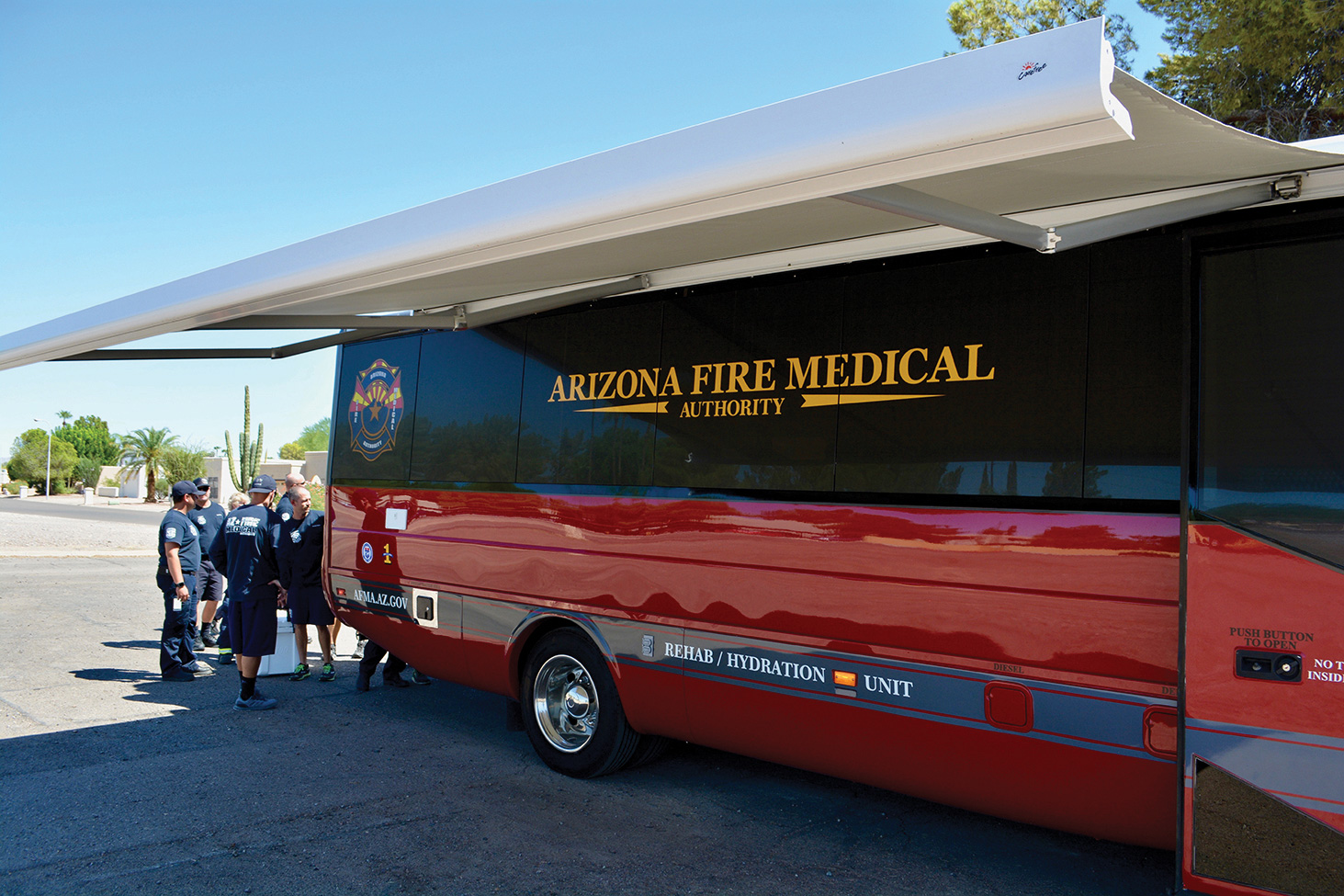 AFMA/Sun Lakes firefighters familiarize themselves with the new rehabilitation and rehydration unit in front of Station 231 on Sun Lakes Boulevard. (Photo by Brian Curry)