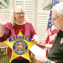 Victoria Romero recites the Arizona Ranger oath from Sun Lakes Captain Ron Burchett.