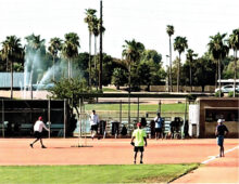 Ronnie Pennington pitching in a recent physically-distanced pick-up game at the Field of Dreams (Photo courtesy of Pitcher Perfect Photoshop)