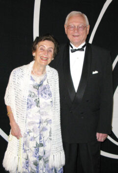 Pictured are Gerhard and Eva Vogelsang entering the ballroom for the Nov. 14, 2014, Live and Let Dance soiree. This dance featured James Bond-themed decorations and musical selections. Gerhard and Eva can always be counted upon to get into the dance theme. Everyone had great fun posing for pictures in their theme-appropriate attire. The meal menu says it all: License to Kill Waldorf salad, The Man from Barbarossa braised beef brisket, SkyFall roasted airline chicken, For Your Eyes Only handmade squash ravioli, Gold Finger-ling potatoes, Thunderball broccoli, and Die Another Day carrot cake. We are looking forward to another great season.