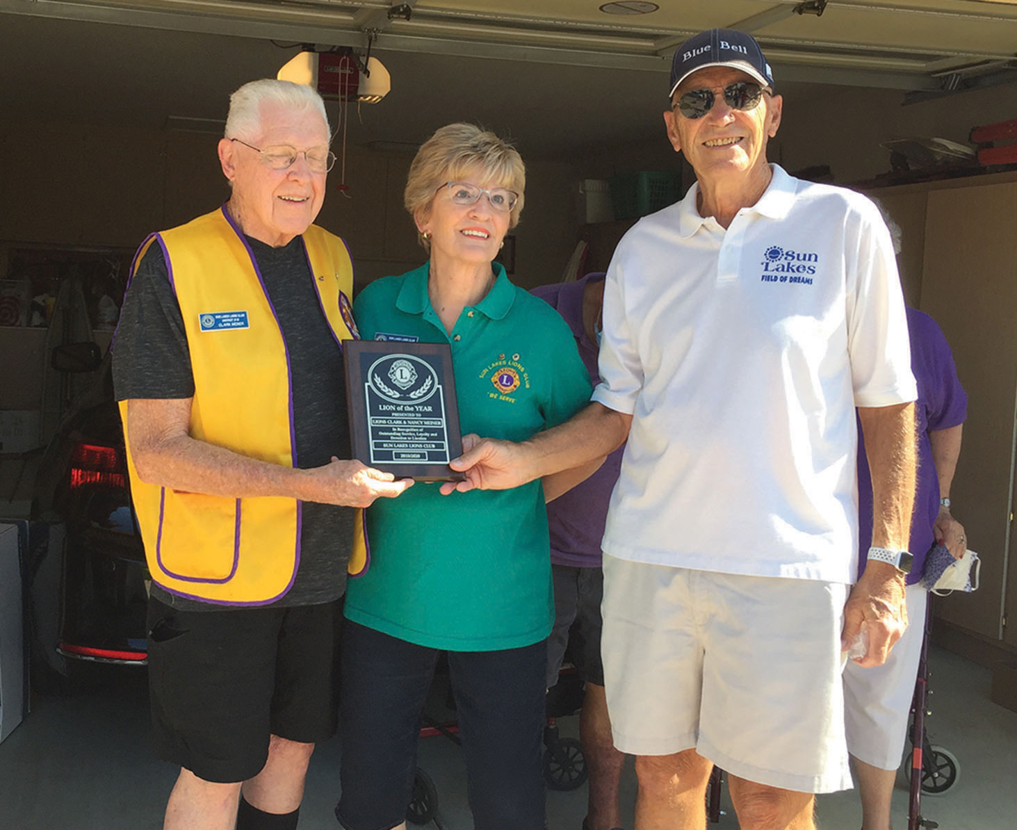 Sun Lakes Lions President Floyd Mullen with Lions of the Year Clark and Nancy Meiner
