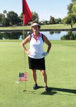 SLLGA President Nancy O'Donnell planting her flag