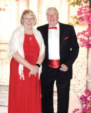 "Pictured are Barry Tomsich and Gail Nelson entering the ballroom for the Feb. 8, 2020, ""All Dolled Up Black Tie Soiree"" with a Valentine twist. Barry and Gail looked great in their Valentine-themed attire. Barry and Gail made use of the group dance lessons last season and looked great on the dance floor. We are looking forward to another great season of fine food, great service, music, dancing, and fellowship."
