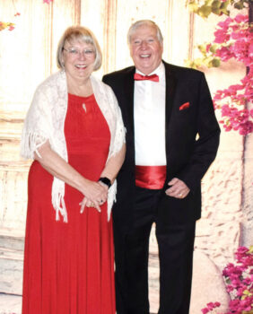 """Pictured are Barry Tomsich and Gail Nelson entering the ballroom for the Feb. 8, 2020, """"All Dolled Up Black Tie Soiree"""" with a Valentine twist. Barry and Gail looked great in their Valentine-themed attire. Barry and Gail made use of the group dance lessons last season and looked great on the dance floor. We are looking forward to another great season of fine food, great service, music, dancing, and fellowship."""