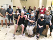 Cast and crew of 'Laughter Is the Best Medicine' pose for a face-masked picture.