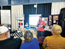 Kim Rosenlof speaking on seed saving at the county fair