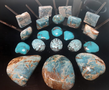 Doug Williams' turquoise is in different phases, starting with raw stone slab and ending in a cabochon.