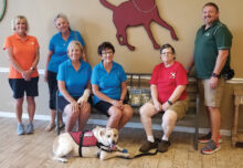 Left to right: Diane Van Compernolle, assistant trainer; committee members Val Verbeck, Mary Horn, and Judy Daidone; Sun Lakes resident Diane Holowinski and her dog Buddy; Shaun Claseman, executive director