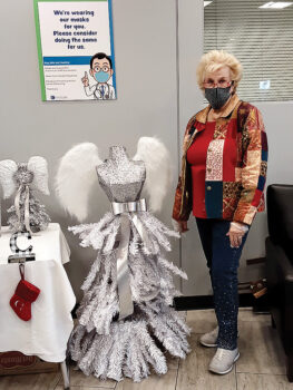 Rose Pachura next to the silver angel tree