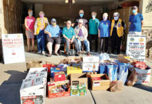 Pictured are the food items and Lions Club members.