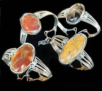 Wire wrapped bangle bracelets by Don Hall, stones (left to right): onyx and red jasper found at Sycamore Creek, petrified wood, and yellow onyx