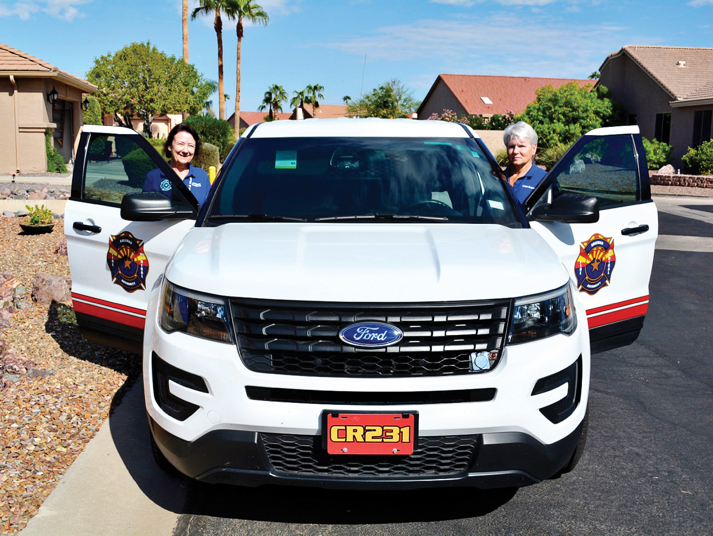 """Arizona Fire & Medical Authority Fire Corps members LouAnn Sedgwick (left) and Colleen Mitchell (right) are just waiting to return to """"active duty"""" in Sun Lakes, as AFMA medics do battle with COVID-19. (Photo by Brian Curry)"""