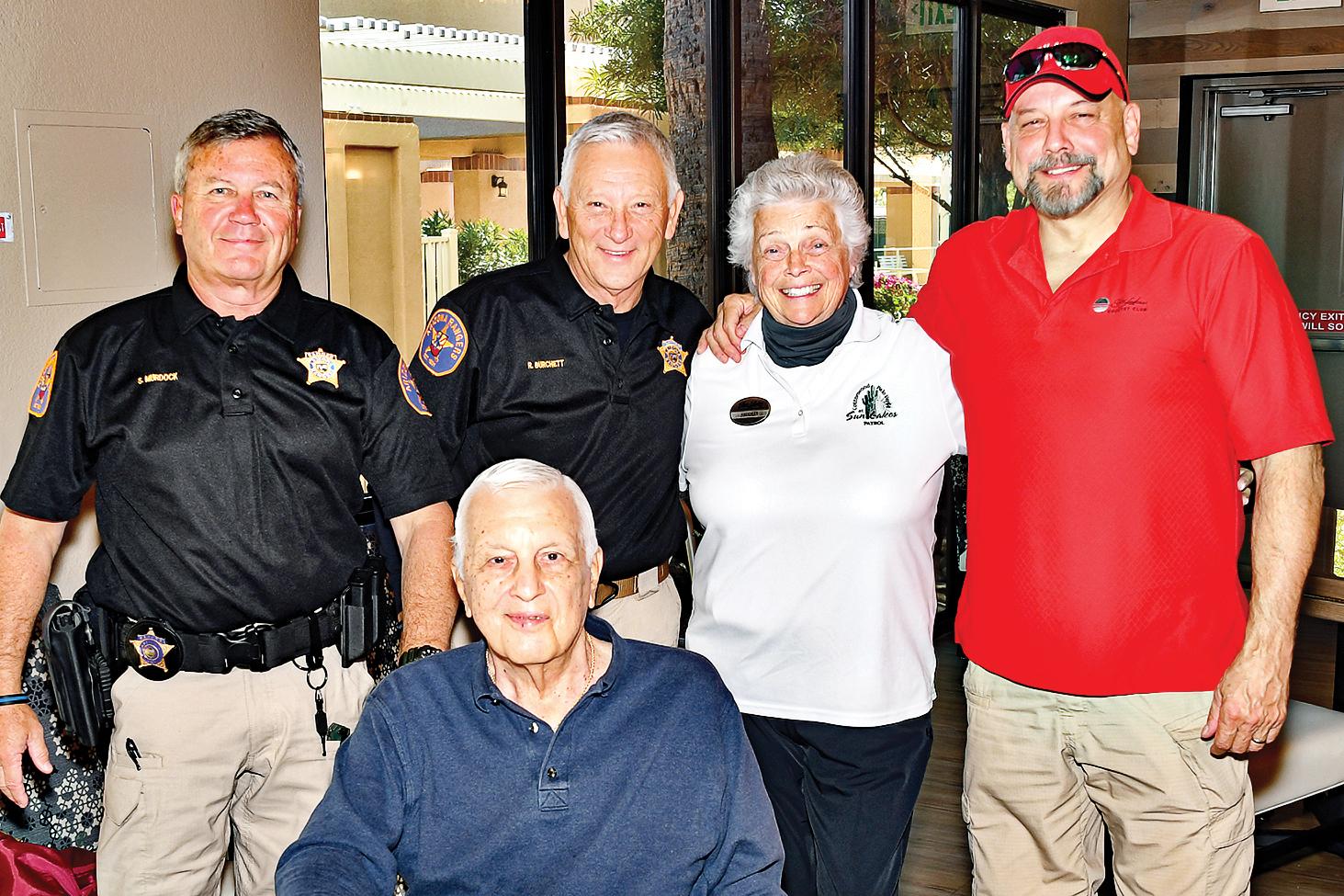 Pictured are Scott Murdock, Jim Curcio (seated), Ron Burchett, Shirley Pierini, and Tim Kelly