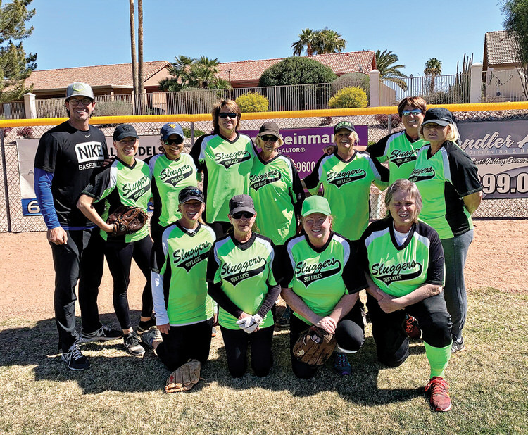The 2021 Lady Sluggers: kneeling (left to right): Crissy Conners, Roseanne Kuefner, Ann Buckley, and Lynn Casey; back row (left to right): Coach Scott Steinmann, Suzy Steinmann, Ann Hegney, Sharon Bergan, Teresa Dorman, Manager Terry Finley, Sue Rodke, and Mary Alka