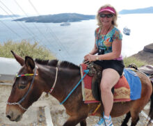 Cheryl Hungate riding a donkey up to Santorini, Greece, before COVID