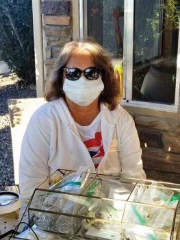 Patty O'Neill, DAR member, Gila Butte Chapter. No, she is not in the witness protection program, LOL. This photo was taken at our annual fundraising garage sale. In all of the photos taken that weekend, our faces are half hidden behind our COVID masks! (Sorry, I don't think you will be able to recognize her at the Safeway!)