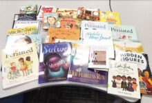 Books labeled, laminated, and ready for students to read at San Marcos Elementary School (Photo sent with a thank you by Jolene Gallup, media specialist at San Marcos)