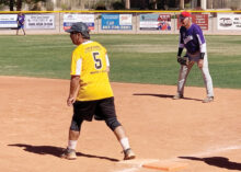 A photo from the Sun Division championship game: Dave Martin is on base as first basemen. Dave Waibel awaits the next pitch. (Photo courtesy of Captured Moments Pictures)