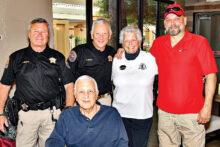Pictured are Scott Murdock, Jim Curcio (seated), Ron Burchett, Shirley Pierini, and Tim Kelly.