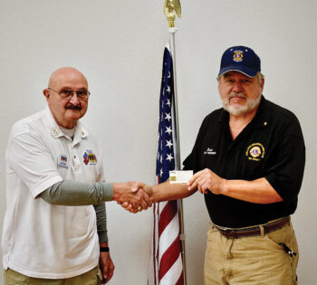 Sun Lakes Breakfast Lions Club President Bob Glantz presents to member Brian Curry.