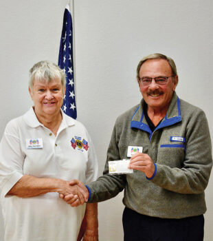 First Vice President Mary Ann Miller presents to member Robert Scully.