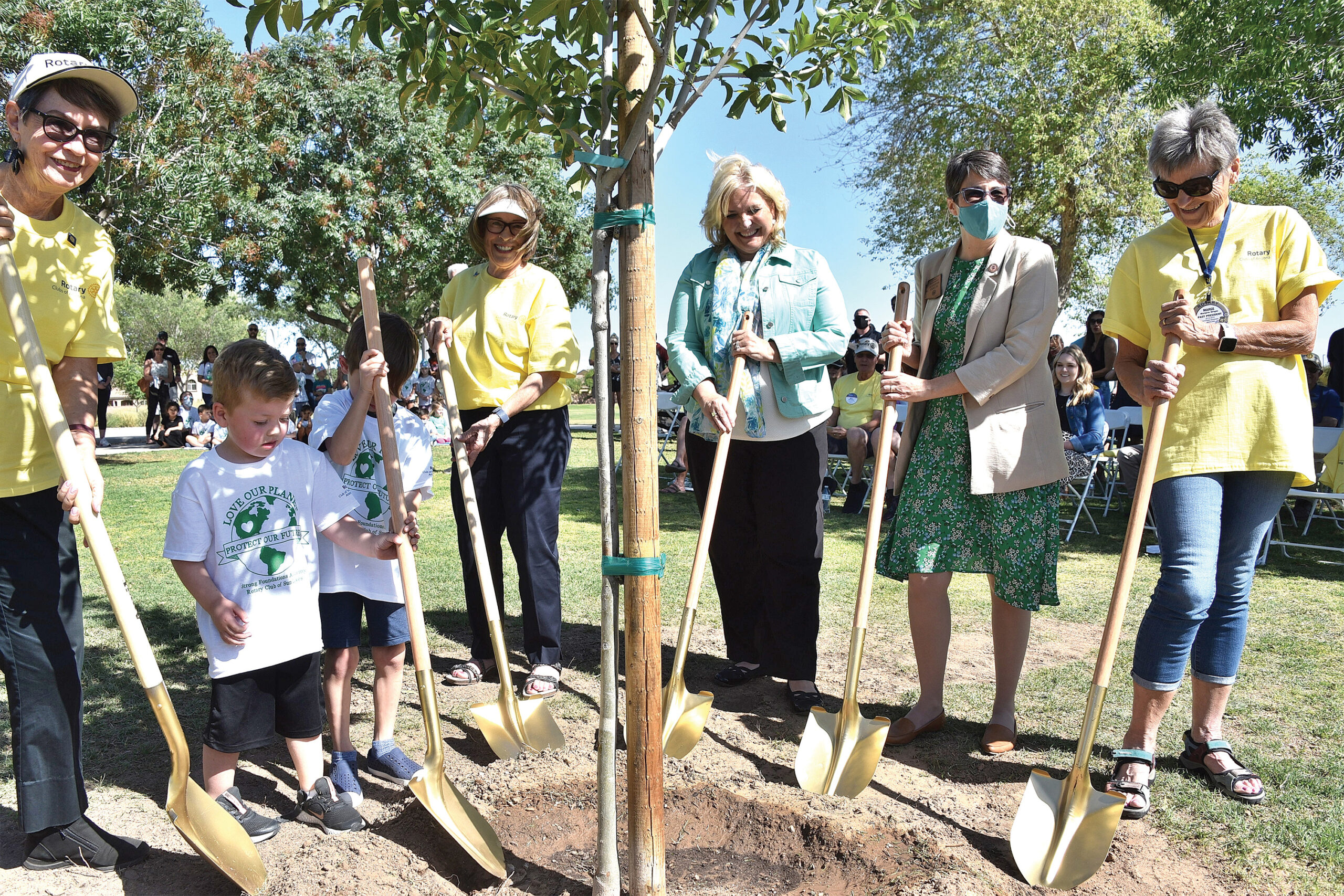 Left to right: Judi Edmonds, Head of Sun Lakes Rotary Club Peace Builder Committee; Daxton Neal (age 3) and Ben Bradley (age 5), Strong Foundations Academy; Nancy Van Pelt, District 5495 Peace Builder Chair and Past District Governor; Terri Kimble, President/CEO of Chandler Chamber of Commerce; Jennifer Pawlik, State Representative for District 17; and Marge Wright, Project Manager on the Tree Celebration Event for SLRC