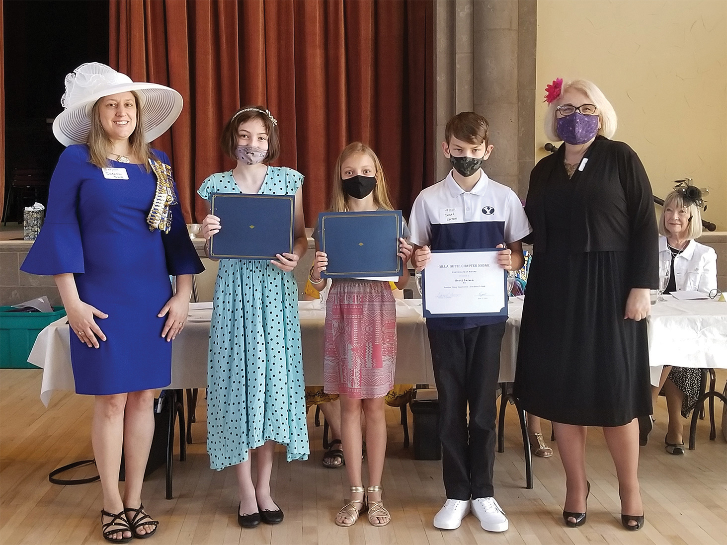 Voyage of the Mayflower Essay Contest winners: Elly Proctor, Alyssa Larsen, and Scott Larsen, flanked by Suzanne Young (left) and Tina Bakalis (right)