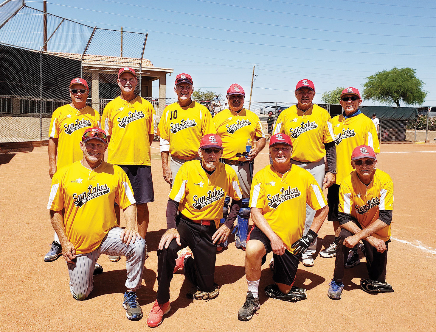 The Champs: Front (kneeling, left to right): Jon Hendrikse, Paul Gayer, Bob Reed, and Rick Oien. Back (left to right): Sam Giordano, Tom Schneider, Dave Waibel, Randy Neumann, Marty Hobby, and Kelly Anderson